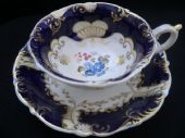 SOLD Daniel tea cup & saucer navy ground / blue flowers